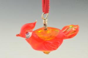 blown red bird