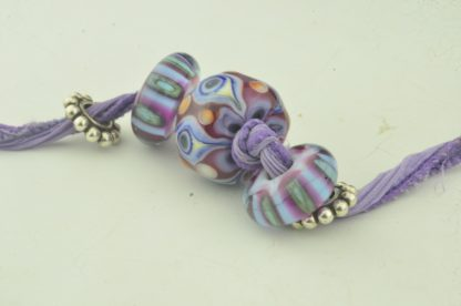 purple magenta periwinkle eye w/ side beads